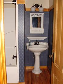 Pedestal sink and mirror in the Blue room